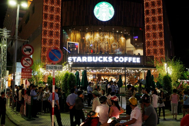 Customers line up to purchase drinks inside on the opening day of  the first Starbucks outlet in Ho Chi Minh City   (STR/AFP/Getty Images)
