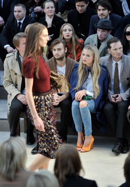 LONDON, ENGLAND - FEBRUARY 18:  (L-R) Tom Hooper, Douglas Booth, Gabriella Wilde in the front row of the Burberry Prorsum Autumn Winter 2013 Womenswear show on February 18, 2013 in London, England.  (Photo by Gareth Cattermole/Getty Images for Burberry)