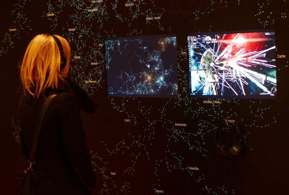 A visitor looks at a demonstration of the video game EVE Online (2003) during an exhibition preview featuring 14 video games acquired by The Museum of Modern Art (MoMA)  in New York, March 1, 2013. The MoMA acquired 14 video games entering its collection as part of an ongoing research on interaction design. AFP PHOTO/EMMANUEL DUNAND        (Photo credit should read EMMANUEL DUNAND/AFP/Getty Images)