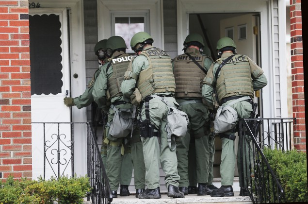 This photo, taken in Watertown, MA on April 19, 2013 as SWAT team members searched for Boston Marathon bombing suspect Dzhokhar A. Tsarnaev, isn't all that different from what ordinary innocent Wisconsin residents experienced as prosecutors served 'John Doe' warrants, which have now been ruled unconstitutional.  (Mario Tama/Getty Images)