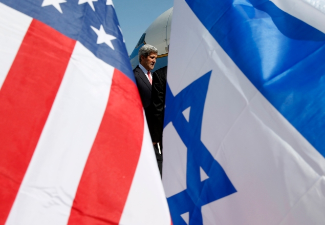 US Secretary of State John Kerry is seen between American (L) and Israeli flags as he arrives in Tel Aviv on May 23, 2013, as he keeps up a push to bring Israelis and Palestinians back to peace negotiations amid a growing scepticism over his efforts. (Photo: JIM YOUNG/AFP/Getty Images)