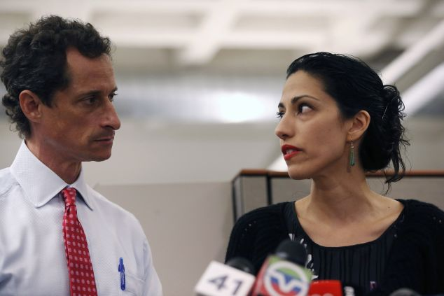 Count Anthony Weiner and wife Huma Abedin, who has worked for Clinton for two decades, among her loyal backers. (John Moore/Getty Images)