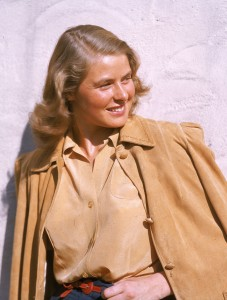 Ingrid Bergman smiles as she poses outdoors, wearing a tan leather jacket, circa 1945. (Photo by Hulton Archive/Getty Images)