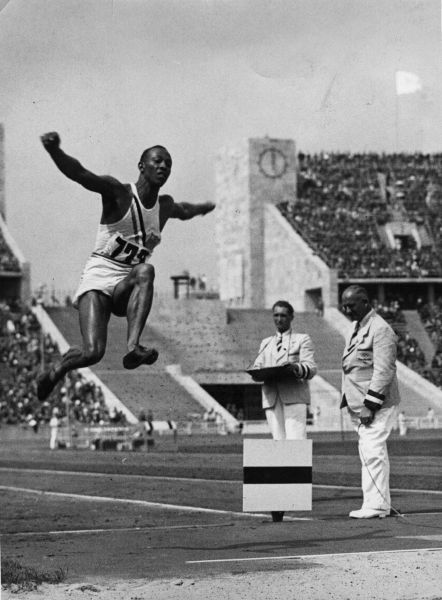 1st June 1936: Athlete Jesse Owens (1913 - 1980) flies through the air during the long jump event at the Olympic Games in Berlin. (Photo by Central Press/Getty Images)