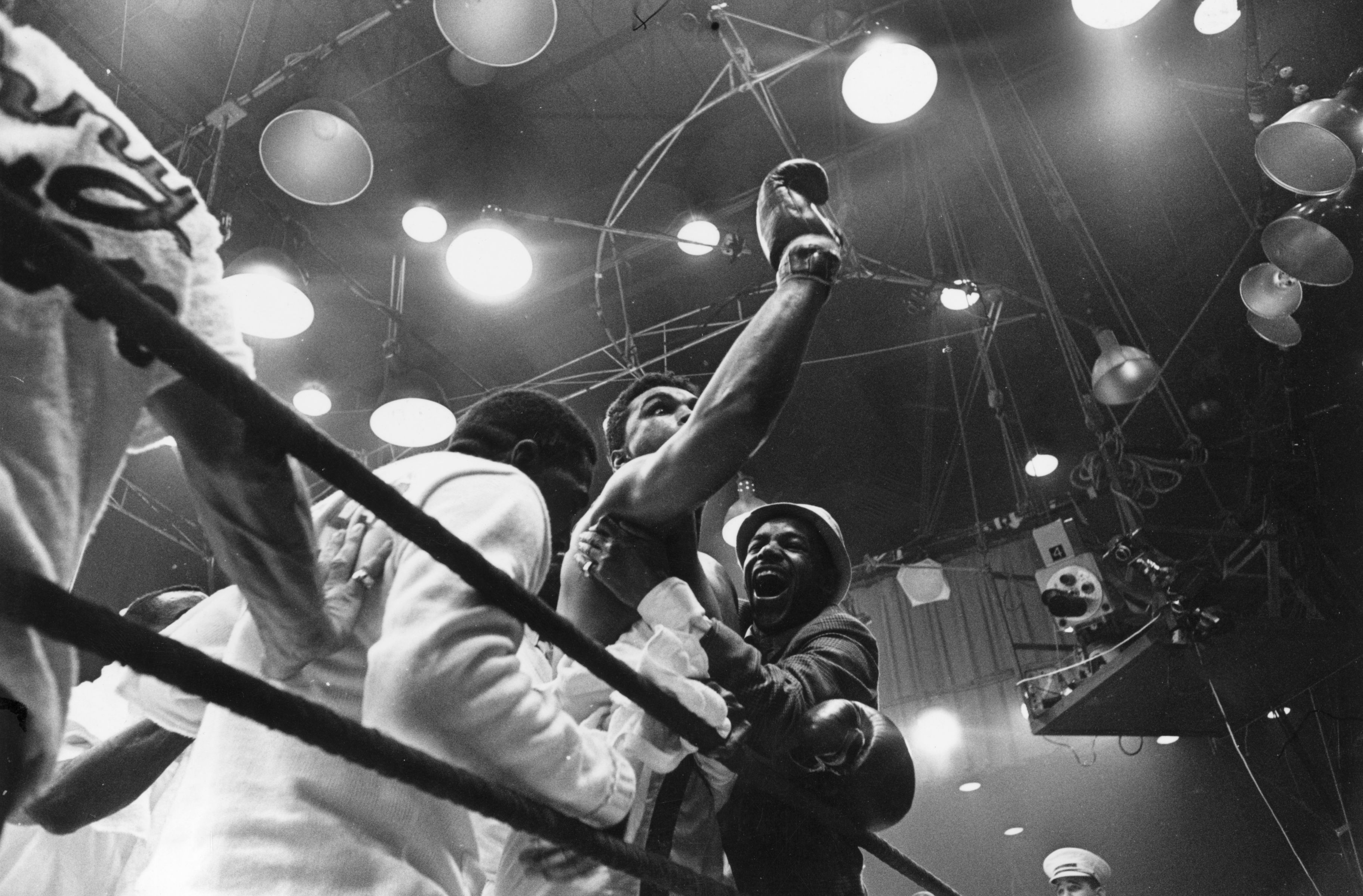 25th February 1964:  American boxer Cassius Clay, later Muhammad Ali, celebrates his win over Sonny Liston in their heavyweight title fight at Miami Beach, Florida. Clay won the contest, becoming world champion for the first time, when Liston failed to come out at the start of the seventh round.  (Photo by Harry Benson/Express/Getty Images)