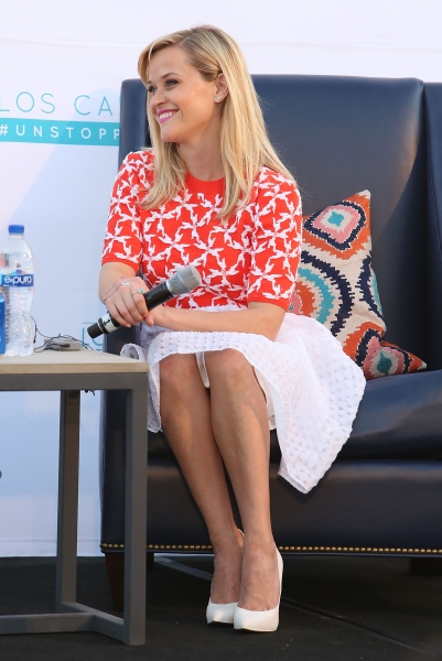 Actress Reese Witherspoon in orange  (Photo: Jesse Grant/Getty Images  for Leisure Opportunities)