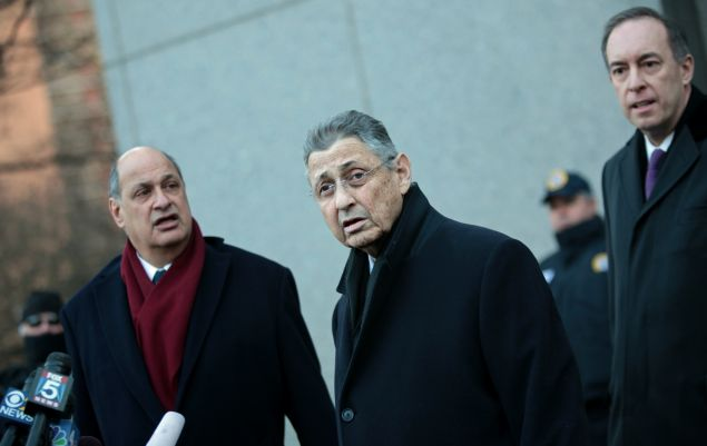New York State Assembly Speaker Sheldon Silver walks out of the Federal Courthouse with his lawyers on January 22. (Photo: Yana Paskova for Getty Images)