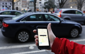 The Uber app and car.  (Photo: Andrew Caballero-Reynolds/AFP/Getty Images)