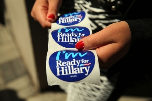 NEW YORK, NY - APRIL 11:  Stickers are handed out to supporters of Hillary Rodham Clinton's yet to be announced presidential campaign at a rally in Manhattan on April 11, 2015 in New York City. It is expected that Clinton will end months of speculation and launch her anticipated 2016 presidential campaign on Sunday with an announcement on social media. Following that it is believed that candidate Clinton will travel to Iowa and New Hampshire, seeking to connect directly with voters in more intimate settings.  (Photo by Spencer Platt/Getty Images)