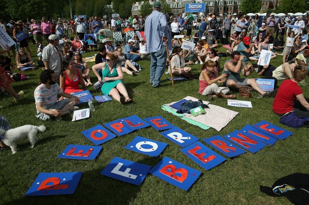 BURLINGTON, VT - MAY 26:  Supporters of Democratic presidential candidate U.S. Sen. Bernie Sanders (I-VT) gather  to watch him officially announce his candidacy for the U.S. presidency during an event at Waterfront Park May 26, 2015 in Burlington, Vermont. Sanders will run as a Democrat in the presidential election and is former Secretary of State Hillary Clinton's first challenger for the Democratic nomination.  (Photo by Win McNamee/Getty Images)