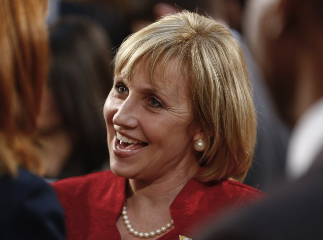 TRENTON--Lt. Gov. Kim Guadagno speaks to a legislator before New Jersey Gov. Chris Christie delivers his budget address for fiscal year 2015 to the Legislature,  February 25, 2014. (Jeff Zelevansky/Getty Images)