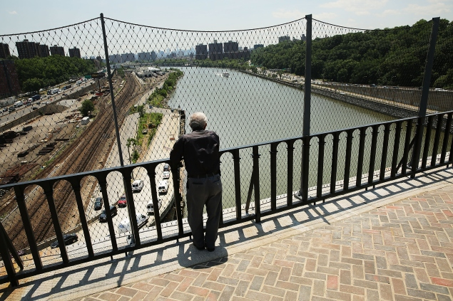 NEW YORK, NY - JUNE 10:  A man looks out from the High Bridge, the city's oldest standing bridge, after it recently opened for the first time since it was closed in the early 1970s on June 10, 2015 in New York City. The bridge, which connects Manhattan and the Bronx and spans over the Harlem River, connects 130 acres of parks in the two boroughs. The bridge opened as part of an aqueduct in the mid-1800s to carry water from the Croton River to upper Manhattan which was running short of water at the time. A walkway was added in 1864. Restorations of the 123-foot tall bridge began in 2012 by the Park Department and cost over $60 million.  (Photo by Spencer Platt/Getty Images)