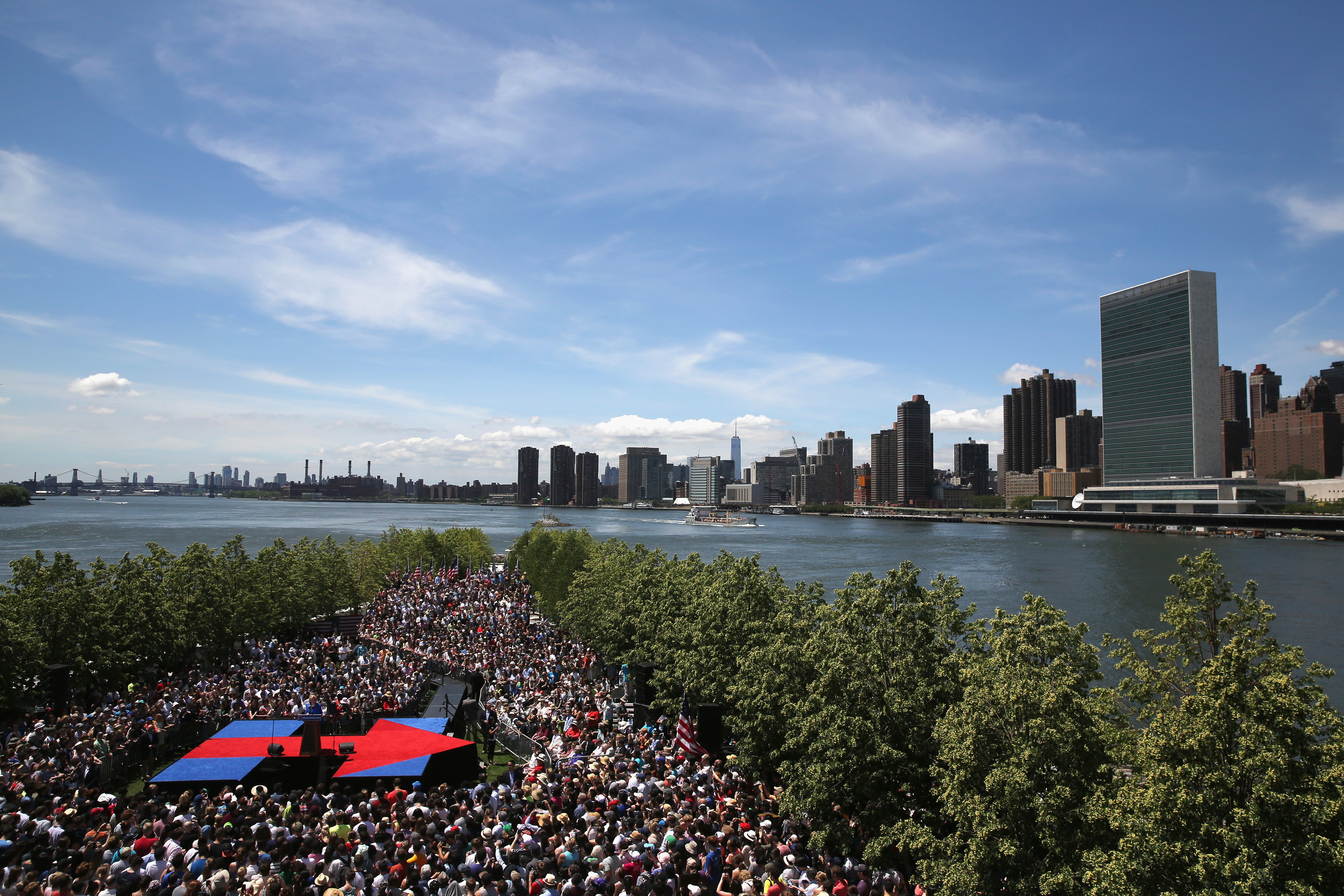 Democratic Presidential candidate Hillary Clinton speaks to supporters at her official campaign launch rally on June 13, 2015 at Roosevelt Island in New York City.  At right is Manhattan and the United Nations headquarters. (Photo by John Moore/Getty Images)