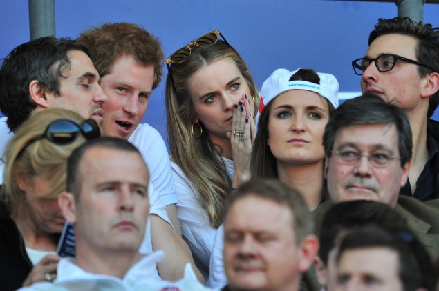 Prince Harry and Ms. Bonas at a 2014 rugby match. (Photo: GLYN KIRK/AFP/Getty Images)