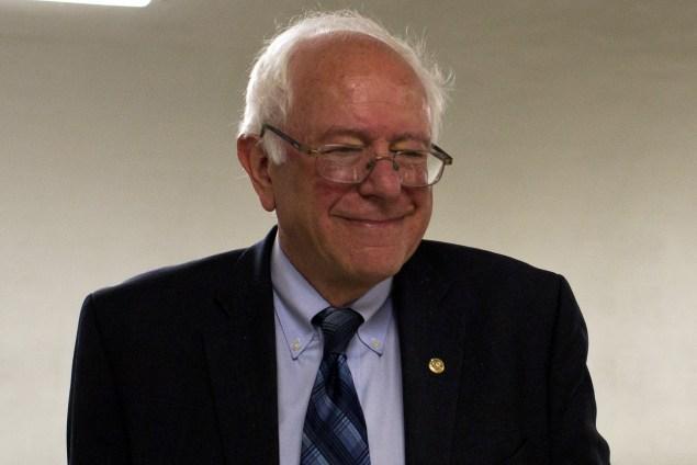 Democratic presidential hopeful Senator Bernie Sanders (I-VT) smiles as he walks along a corridor in the Senate in Washington, DC, on June 17, 2015. AFP PHOTO/ ANDREW CABALLERO-REYNOLDS        (Photo credit should read Andrew Caballero-Reynolds/AFP/Getty Images)