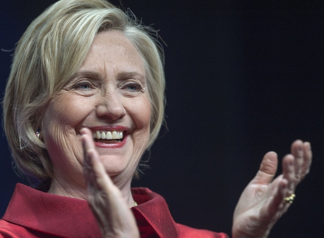 Former Secretary of State and Democratic presidential hopeful Hillary Clinton listens to her introduction before delivering remarks at the Virginia Democrats Jefferson-Jackson event at George Mason University's Patriot Center in Fairfax, Virginia on June 26, 2015. (Photo: PAUL J. RICHARDS/AFP/Getty Images)