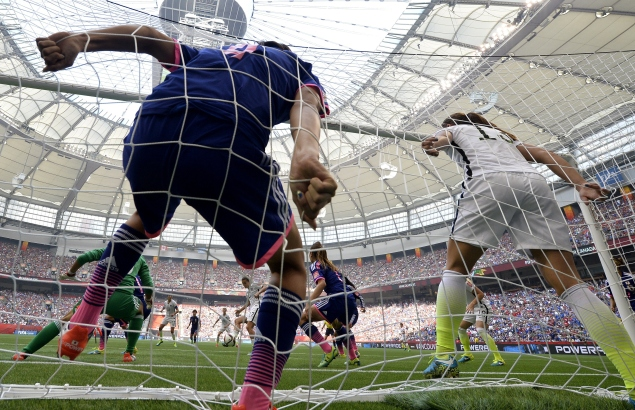 USA midfielder Tobin Heath (C) scores a goal in front of Japan's goalkeeper Ayumi Kaihori (L) and Japan's defender Saki Kumagai during the final football match between USA and Japan during their 2015 FIFA Women's World Cup at the BC Place Stadium in Vancouver on July 5, 2015.  AFP PHOTO / FRANCK FIFE        (Photo credit should read FRANCK FIFE/AFP/Getty Images)