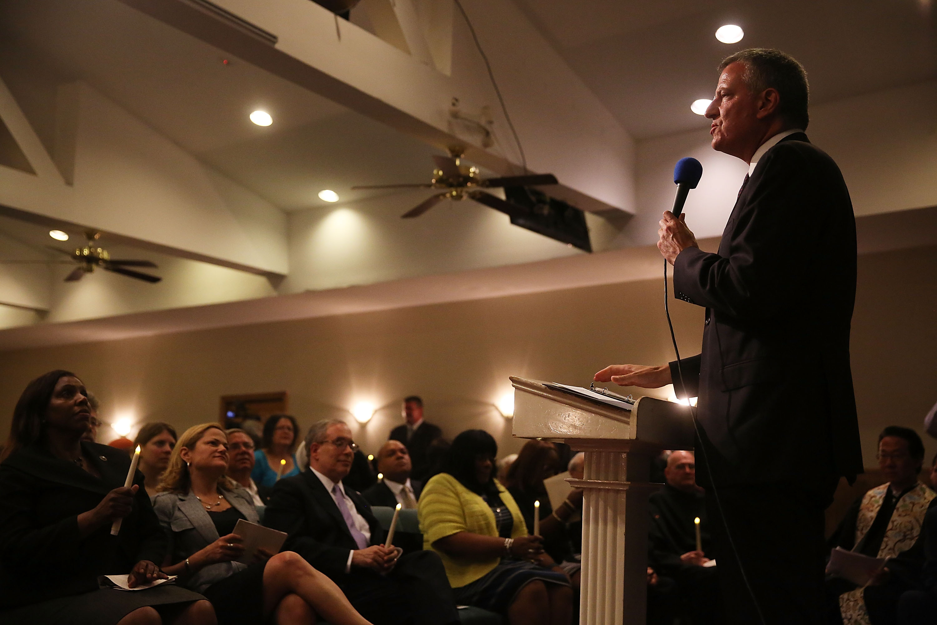 Mayor Bill de Blasio speaks at an interfaith prayer service at Mount Sinai United Christian Church to mark the one-year anniversary of the death of Eric Garner (Photo by Spencer Platt/Getty Images)
