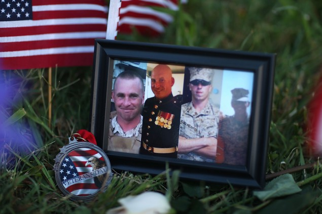 CHATTANOOGA, TN - JULY 18:  A photograph of the victims is seen among the memorial setup in front of the Armed Forces Career Center/National Guard Recruitment Office on July 18, 2015 in Chattanooga, Tennessee. According to reports, Mohammod Youssuf Abdulazeez, 24, opened fire on the military recruiting station on July 16th at the strip mall and then drove to an operational support center operated by the U.S. Navy and killed four United States Marines there, more than seven miles away,  (Photo by Joe Raedle/Getty Images)