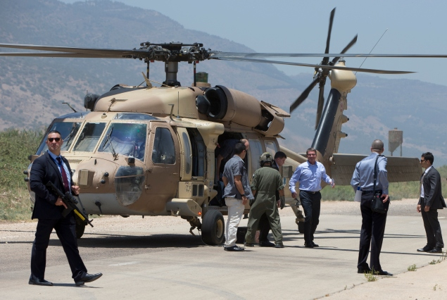 U.S. Defense Secretary Ash Carter, third from right, and Israeli Defense Minister Moshe Ya'alon arrive on a UH-60 Blackhawk helicopter at a Hula Valley landing zone near Yesod Hamala, Israel, Monday, July 20, 2015, in norther Israel near the Lebanon boarder, en route to view the Hula Valley from the Hussein Lookout. Carter said he has no expectation of persuading Israeli leaders to drop their opposition to the Iran nuclear deal, but will instead emphasize that the accord imposes no limits on what Washington can do to ensure the security of Israel and U.S. Arab allies. (AP Photo/Carolyn Kaster, Pool)