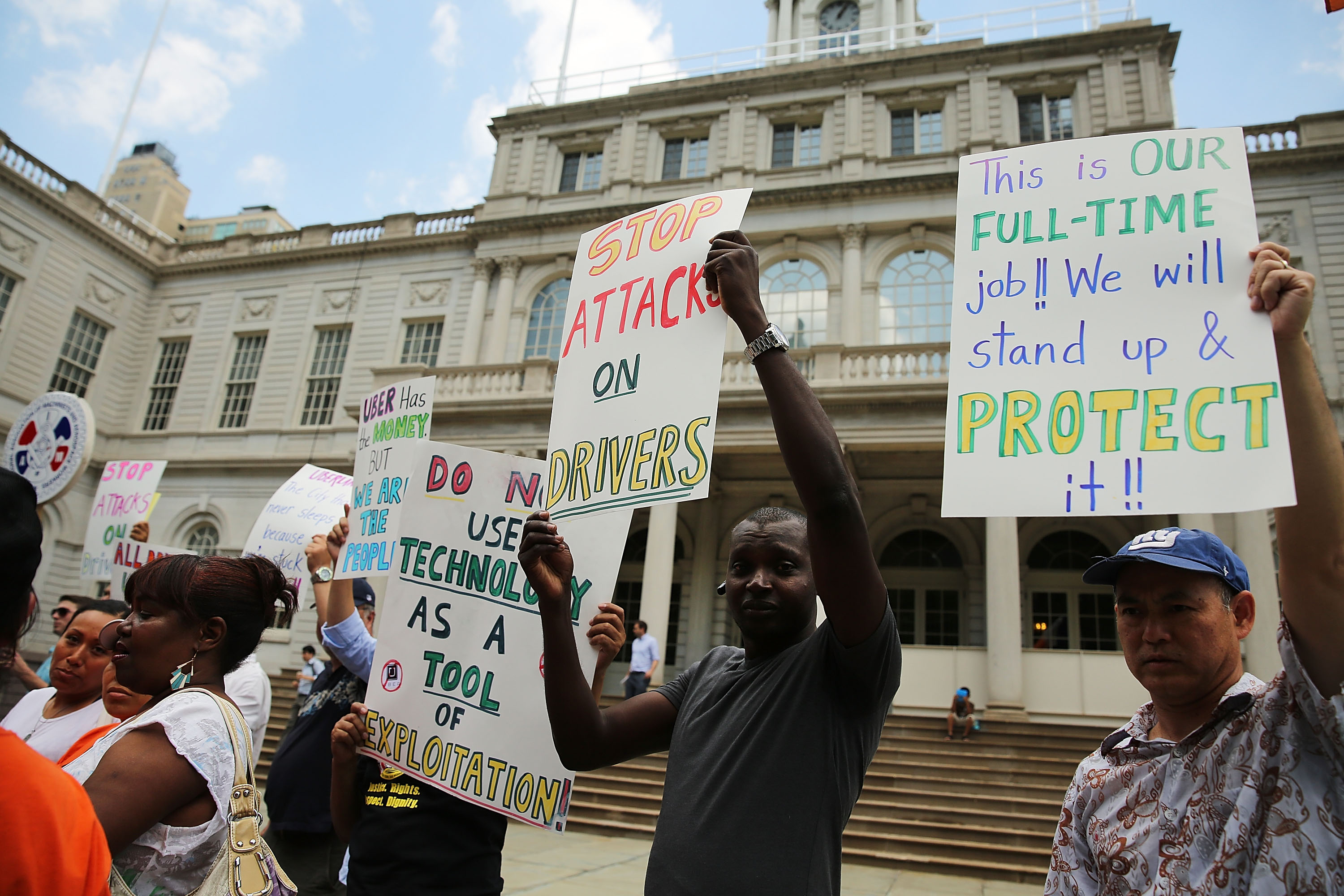 Taxi drivers and progressive groups protest Uber at City Hall this week.  (Photo: Spencer Platt/Getty Images)