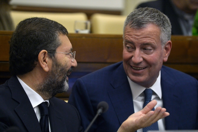 """New York's mayor Bill de Blasio (R) and Rome's mayor Ignazio Marino attend the second day of an international summit of Mayors on """"Modern Slavery and Climate Change"""" on July 21, 2015 at the Vatican. Mayors from around the world have signed a declaration with Pope Francis stating that man-made climate change is real and humanity has a moral imperative to take action. At a two-day summit in the Vatican aimed at spurring efforts to fight global warming following the pope's environment encyclical denouncing the exploitation of the poor and the earth's resources, over 60 mayors pledged to do their part. AFP PHOTO / TIZIANA FABI        (Photo credit should read TIZIANA FABI/AFP/Getty Images)"""