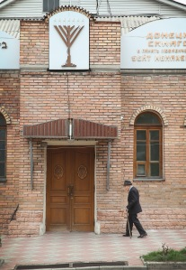 DONETSK, UKRAINE - APRIL 19: A worshiper arrives at a synagogue on April 19, 2014 in Donetsk, Ukraine. Recently someone distributed fliers in Donetsk ordering Jews to register with and pay a $50 fee to the pro-Russian activists who have taken over government buildings in the city. The flier stated those who fail to register could face deportation, loss of citizenship and confiscation of assets. Pro-Russian activists have taken control of government buildings in Donetsk and nearby towns demanding a change of leadership in Ukraine. (Photo by Scott Olson/Getty Images)