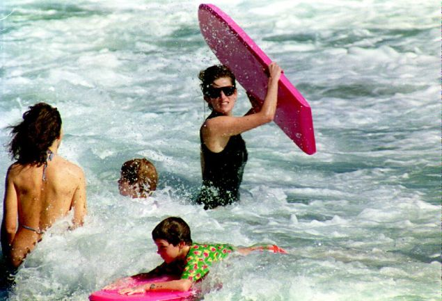 Princess Diana got her surf on during a 1993 holiday to the British Virgin Islands. (Photo credit should read PAUL J. RICHARDS/AFP/Getty Images)