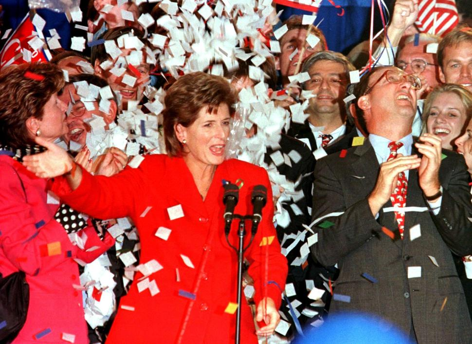 PRINCETON, UNITED STATES:  Governor Christine Whitman (C) of New Jersey, is showered with confetti as her husband, John Whitman (R), looks up after she gave a victory speech in the Princeton Marriott hotel in Princeton, New Jersey, 05 November, after defeating challenger Jim McGreevey, the democratic party candidate. She defeated McGreevey by a one percent margin.  AFP PHOTO  Tom MIHALEK (Photo credit should read TOM MIHALEK/AFP/Getty Images)