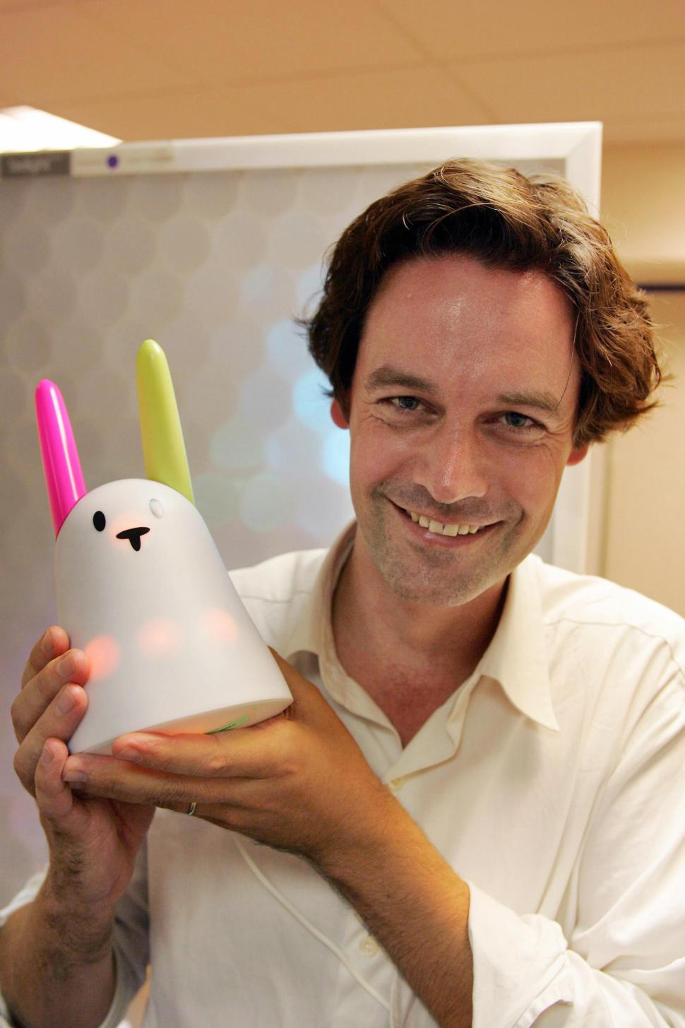 Paris, FRANCE:  Olivier Mevel, head of Violet company, poses, 15 September 2005, with a 'Nabaztag' the first ever released wide-audience communicating device. Along with Violet's co-founder Rafi Haladjian, Mevel called the device ' Nabaztag', which means rabbit in Armenian. It may be connected to other Nabaztags through the Internet, using DSL and wireless means, and thus may, among other things,  play MP3, warn when emails are delivered and do so even when its owner's computer is not connected, thanks to the www.nabaztag.com website it'll be registered to. AFP PHOTO DAMIEN MEYER