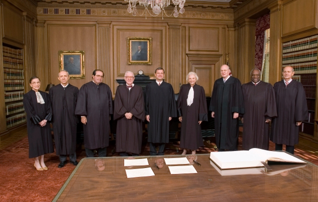 WASHINGTON, DC - OCTOBER 3:  Supreme Court Justices Ruth Bader Ginsburg (L-R), David H. Souter, Antonin Scalia, John Paul Stevens, Chief Justice John Roberts, Justices Sandra Day O'Connor, Anthony M. Kennedy, Clarence Thomas and Stephen G. Breyer pose for the first picture of with Roberts in his position in the Chief Justice Conference Room Monday October 3, 2005, at the Supreme Court in Washington, D.C.  (Photo by Ken Heinen/U.S. Supreme Court via Getty Images)