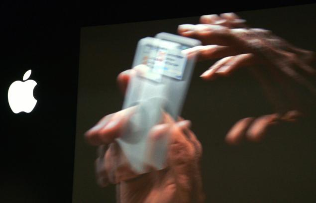 "A giant screen shows a video presenting the miniaturized iPod called the ""nano"", (Photo: JOEL SAGET/AFP/Getty Images)"