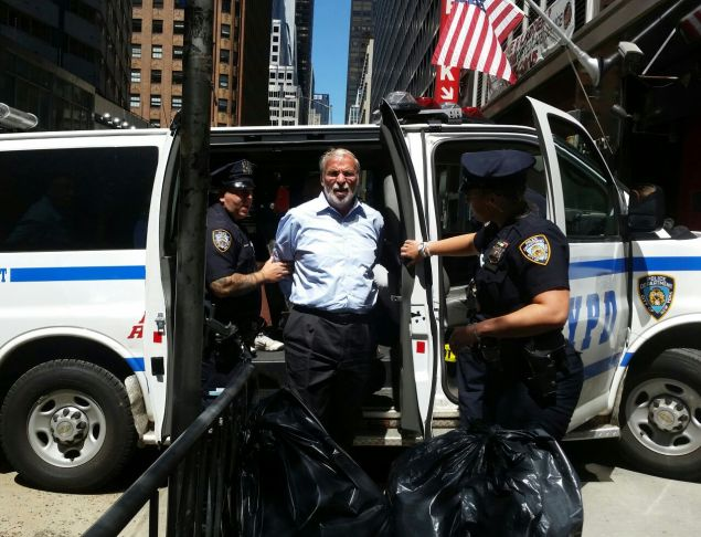 Assemblyman Dov Hikind in police custody (Photo: Assemblyman Dov Hikind's Office).