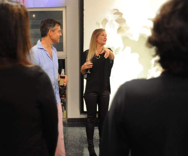 Kathryn and Dan Mikesell speaking at the Perez Art Museum's Core Creative dinner at their home.