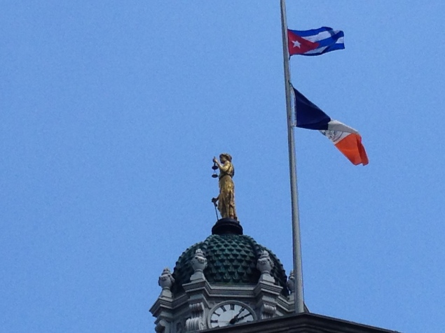 The Cuban flag hoisted over the New York State banner atop Brooklyn Borough Hall (Photo: Will Bredderman/New York Observer).