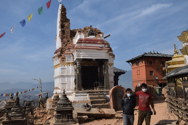 One of the collapsed Sikhara-type temples at Swayambhu, after the April 25, 2015, earthquake. (Photo: © DirghaMan & GaneshMan Chitrakar Art Foundation, Courtesy The Rubin Museum of Art)