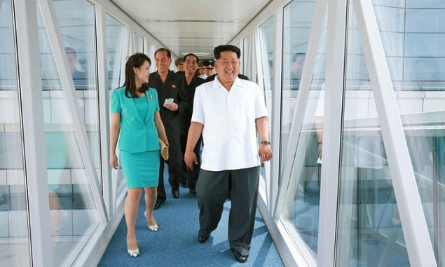 Kim Jong-un actually jubilant with his new airport. (Photo: KNS/AFP/Getty Images via The Guardian)