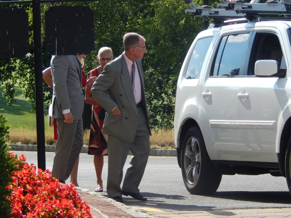 Although it looks as though this Jeb Bush reveler (left) arrived to the fundraiser with a lampshade over his head so as not to be recognized by Chris Christie partisans, if you look closely you can see that black, obfuscating object is actually part of the Navesink Country Club grounds, and not a lampshade.