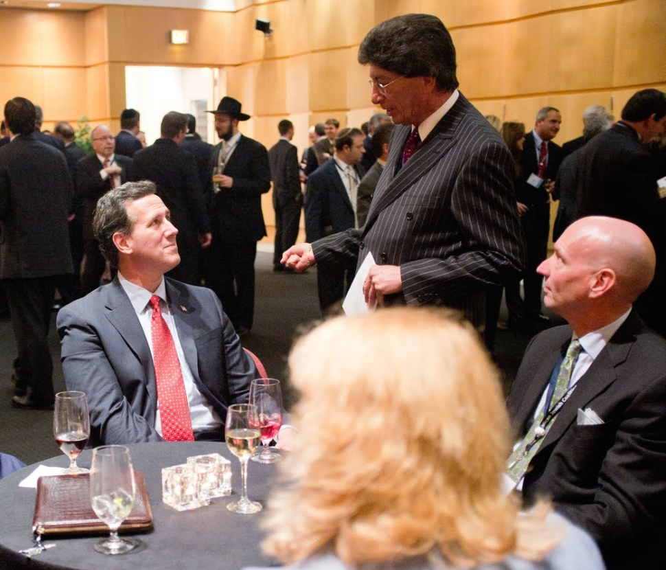 Presidential candidate Rick Santorum and GOP operative Michael Glassner talk to some guy with great hair and a pinstripe suit at the Republican Jewish Coalition meeting in Washington DC in 2012.