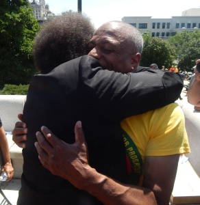 Princeton alumni West, left and Hamm, embrace on the steps of the Essex County Courthouse earlier today.