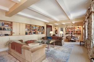 The living room boasts coffered ceilings and lots of memorabilia. (Courtesy Citi Habitats)