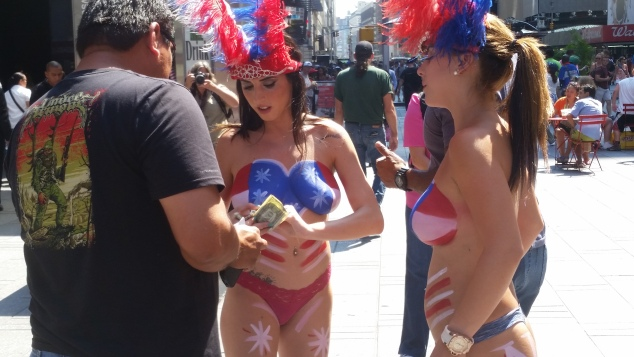 Topless performers in Times Square today. (Photo: Ross Barkan for Observer)