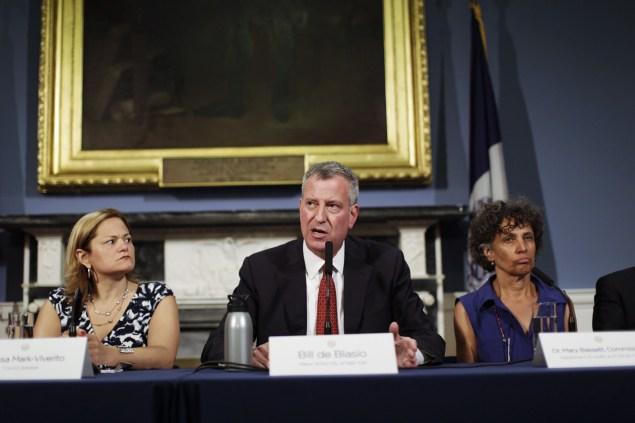 Speaker Melissa Mark-Viverito, Mayor Bill de Blasio and Health Commissioner Dr. Mary Bassett discuss new legislation to combat Legionnaires' disease. (Photo: William Alatriste for the New York City Council)
