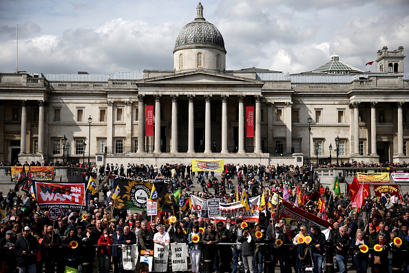 Demonstrators participate in the annual May Day march in Trafalgar Square on May 1, 2015 in London, England. This year, the protests focused on privatization of the National Gallery. (Photo by Dan Kitwood/Getty Images)