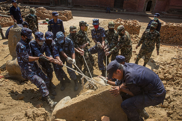 Nepali soldiers work to remove an stone lion from the rubble of a temple in Durbar Square in Patan, Nepal on May 2, 2015. (Photo: Taylor Weidman/LightRocket via Getty Images)