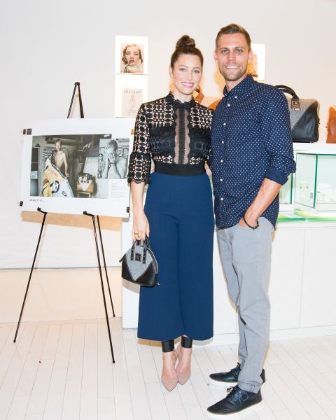 Jessica Biel and brother Justin pose next to one of the photos from the #BareItAll campaign. (Photo: BFA)