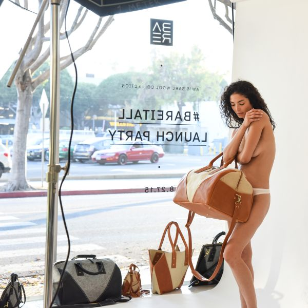 A model poses naked with a BARE duffel. (Photo: BFA)