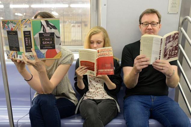 """Bibliobrandishing,"" the showing off of fancy books in public. (Photo: Richard Yeh/WNYC)"
