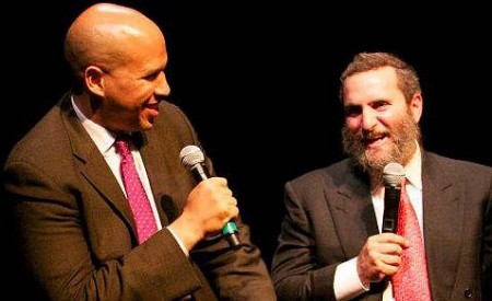 Cory Booker and Shmuley Boteach have shared a stage many times but find themselves at odds over the Iran deal. The exclusion of Boteach from a meeting Booker has convened among Jewish leaders has led some to speculate that the senator wants to hear from only those leaders he can count on not to oppose him as loudly as Boteach has been doing.