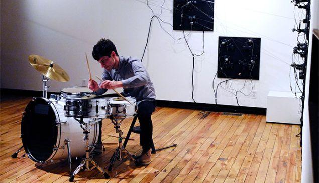 Eli performing on drums.